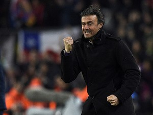 Barcelona's coach Luis Enrique celebrates after a goal during the Spanish league football match FC Barcelona vs Club Atletico de Madrid at the Camp Nou stadium in Barcelona on January 11, 2015