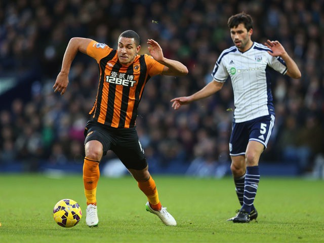 Jake Livermore of Hull City evades Claudio Yacob of West Bromwich Albion during the Barclays Premier League match between West Bromwich Albion and Hull City at The Hawthorns on January 10, 2015