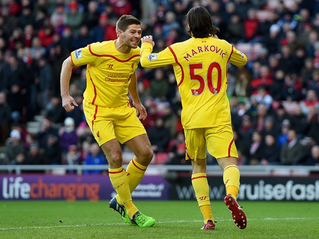 Lazar Markovic of Liverpool celebrates scoring the opening goal with Steven Gerrard during the Barclays Premier League match between Sunderland and Liverpool at Stadium of Light on January 10, 2015