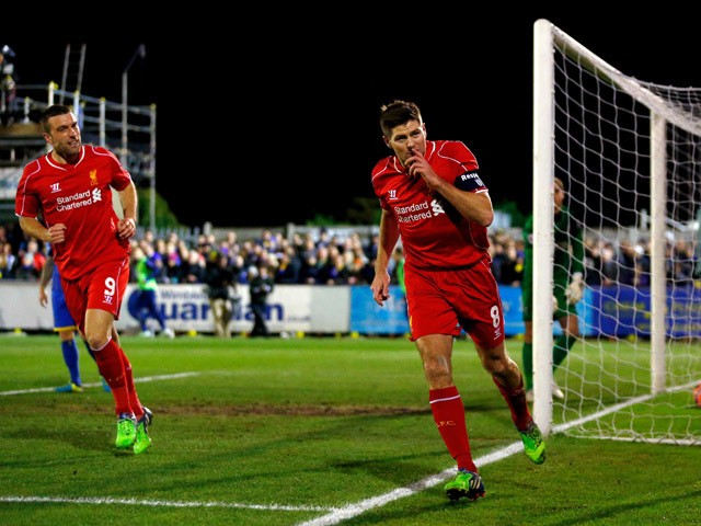Steven Gerrard of Liverpool celebrates after scoring the opening goal with a header during the FA Cup Third Round match between AFC Wimbledon and Liverpool at The Cherry Red Records Stadium on January 5, 2015