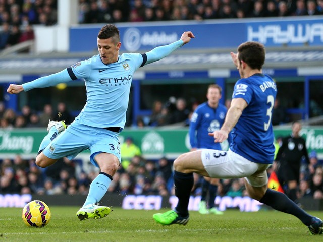 Stevan Jovetic of Manchester City takes a shot on goal as Leighton Baines of Everton atempts to block during the Barclays Premier League match between Everton and Manchester City at Goodison Park on January 10, 2015
