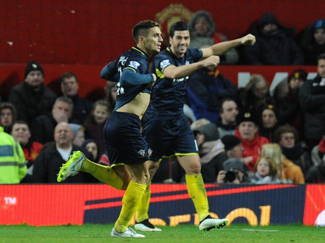Southampton's Serbian midfielder Dusan Tadic removes his shirt as he celebrates scoring the opening goal during the English Premier League football match between Manchester United and Southampton at Old Trafford in Manchester, north west England, on Janua