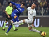 Alvaro Morata (L) of Juventus FC in action against Guillermo Daniel Rodriguez Perez of Hellas Verona FC during the TIM Cup match on January 15, 2015