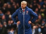 Arsenal manager Arsene Wenger stands with hands on hips while wearing his ridiculous coat on January 18, 2015