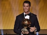 Real Madrid and Portugal forward Cristiano Ronaldo smiles after receiving the 2014 FIFA Ballon d'Or award for player of the year during the FIFA Ballon d'Or award ceremony on January 12, 2015