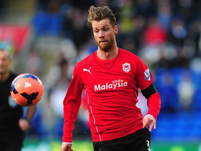 Jo Inge Berget of Cardiff in action during the FA Cup Fifth Round match between Cardiff City and Wigan Athletic at Cardiff City Stadium on February 15, 2014