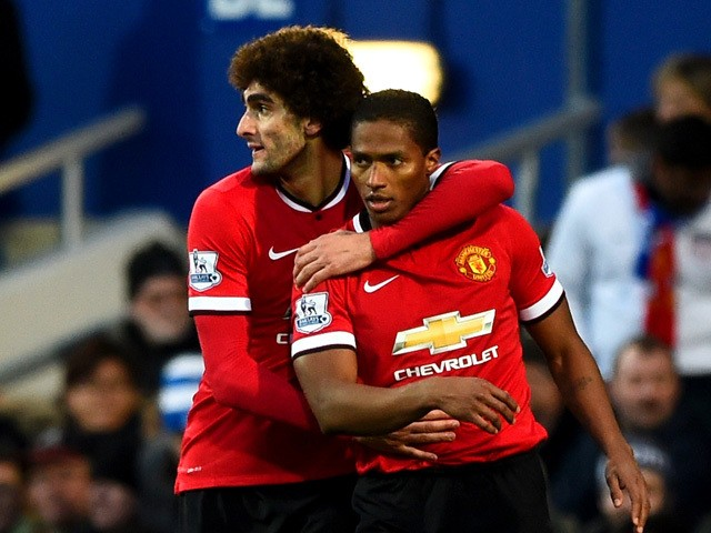 Marouane Fellaini of Manchester United celebrates with team-mate Luis Antonio Valencia after scoring the opening goal during the Barclays Premier League match between Queens Park Rangers and Manchester United at Loftus Road on January 17, 2015
