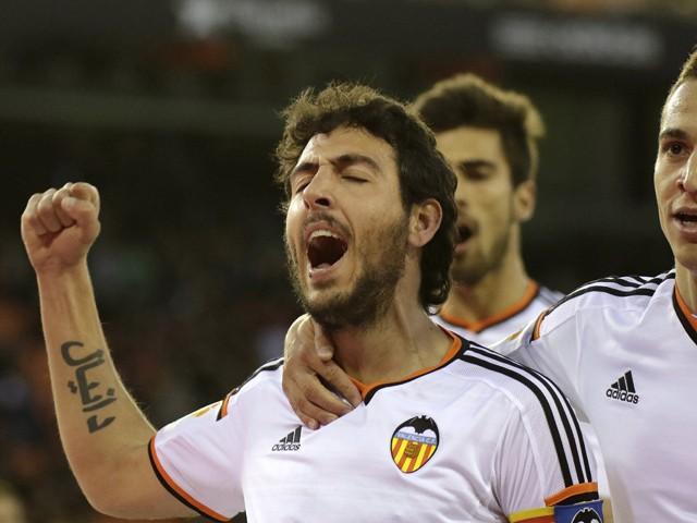 Valencia's midfielder Daniel Parejo celebrates after scoring during the Spanish league football match Valencia CF vs Almeria UD at the Mestalla stadium in Valencia on January 17, 2015