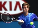 Slovenia's Aljaz Bedene plays a shot during his men's singles match against Serbia's Novak Djokovic on day two of the 2015 Australian Open tennis tournament in Melbourne on January 20, 2015