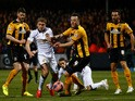 James Wilson of Manchester United battles for the ball with Josh Coulson of Cambridge United during the FA Cup Fourth Round match between Cambridge United and Manchester United at The R Costings Abbey Stadium on January 23, 2015