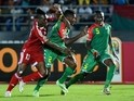 Congo's forward Thierry Bifouma (L) challenges Burkina Faso's defender Steeve Yago and Burkina Faso's defender Mohamed Koffi (R) during the 2015 African Cup of Nations match on January 25, 2015