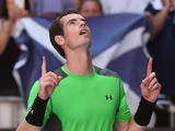 Britain's Andy Murray celebrates after beating Joao Sousa of Portugal in their men's singles match on day five of the 2015 Australian Open tennis tournament in Melbourne on January 23, 2015