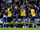 Theo Walcott of Arsenal celebrates with team-mates Aaron Ramsey and Mathieu Flamini after scoring the opening goal during the FA Cup Fourth Round match between Brighton & Hove Albion and Arsenal at Amex Stadium on January 25, 2015