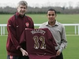 Arsenal Manager Arsene Wenger and new signing Theo Walcott, 16, pose for the media at the Arsenal training ground on January 20, 2006