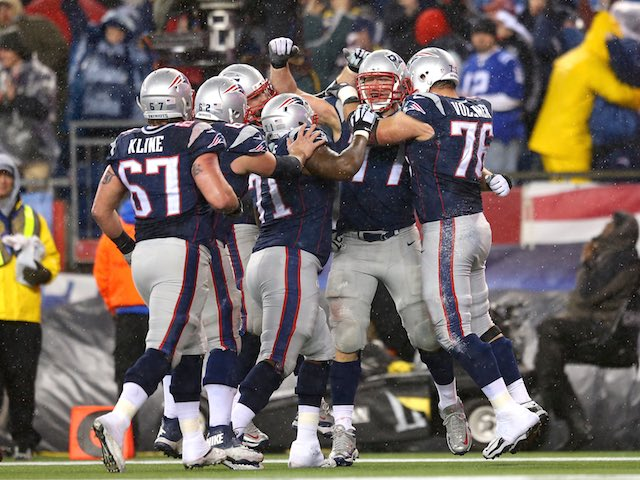 Nate Solder of the New England Patriots celebrates with teammates during the AFC Championship game on January 18, 2015