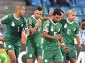 Algerian players celebrate after scoring a goal during the 2015 African Cup of Nations group C football match between Senegal and Algeria, on January 27, 2015