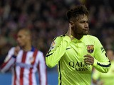 Barcelona's Brazilian forward Neymar celebrates after scoring his second goal during the Spanish Copa del Rey (King's Cup) quarter final second leg football match Club Atletico de Madrid vs FC Barcelona at the Vicente Calderon stadium in Madrid on January