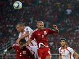 Equatorial Guinea's defender Diosdado Mbele and Equatorial Guinea's midfielder Randy head the ball with Tunisia's forward Ahmed Akaichi during the 2015 African Cup of Nations quarter-final football match between Equatorial Guinea and Tunisia in Bata on Ja