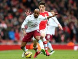 Fabian Delph of Aston Villa is challenged by Hector Bellerin of Arsenal during the Barclays Premier League match on February 1, 2015