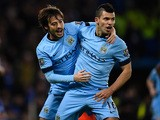 Goalscorer David Silva of Manchester City celebrates with teammate Sergio Aguero after scoring the equalising goal during the Barclays Premier League match between Chelsea and Manchester City at Stamford Bridge on January 31, 2015