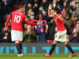 Radamel Falcao of Manchester United celebrates with teammate Wayne Rooney (L) of Manchester United after scoring his team's second goal during the Barclays Premier League match between Manchester United and Leicester City at Old Trafford on January 31, 20