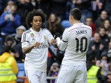 Real Madrid's Colombian midfielder James Rodriguez celebrates with Real Madrid's Brazilian defender Marcelo during the Spanish league football match Real Madrid CF vs Real Sociedad de Futbol at the Santiago Bernabeu stadium in Madrid on January 31, 2015