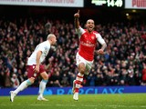 Theo Walcott of Arsenal celebrates after scoring his team's third goal during the Barclays Premier League match against Aston Villa on February 1, 2015