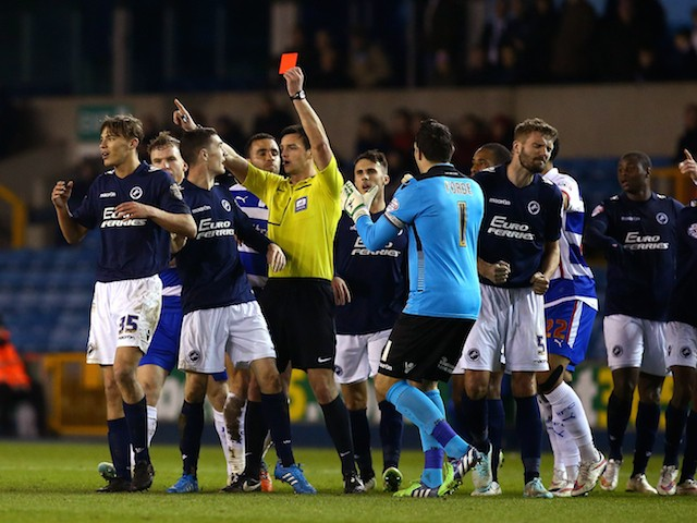 Sid Nelson of Millwall (R) is shown a red card by referee Andrew Madley after he puts a late tackle in on Reading's Nick Blackman during the Sky Bet Championship match on January 27, 2015