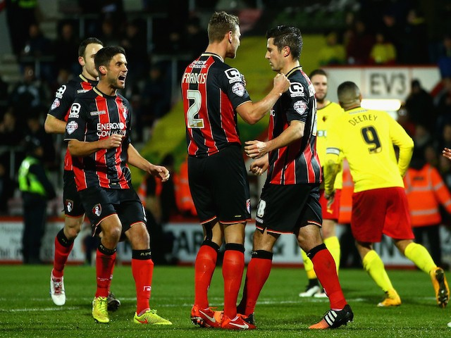 Yann Kermorgant of Bournemouth (R) celebrates scoring the opening goal from the penalty spot against Watford on January 30, 2015