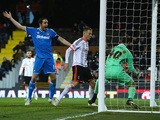 Marcus Bettinelli of Fulham fumbles the ball in to his own net for Sunderland's opening goal as John O'Shea of Sunderland celebrates during the FA Cup Fourth Round Replay match between Fulham and Sunderland at Craven Cottage on February 3, 2015