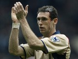 Martin Keown of Arsenal applauds the fans after the AXA sponsored FA Cup Semi-final match between Middlesbrough and Arsenal at Old Trafford