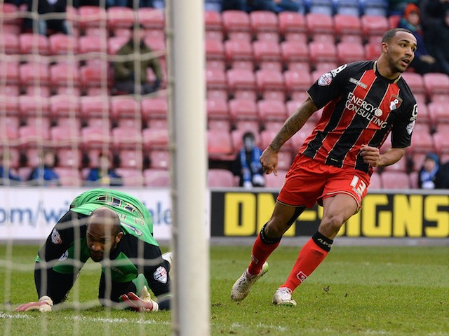 Callum Wilson (R) of AFC Bournemouth reacts after scoring during the Sky Bet Championship match between Wigan Athletic and AFC Bournemouth at DW Stadium on February 7, 2015