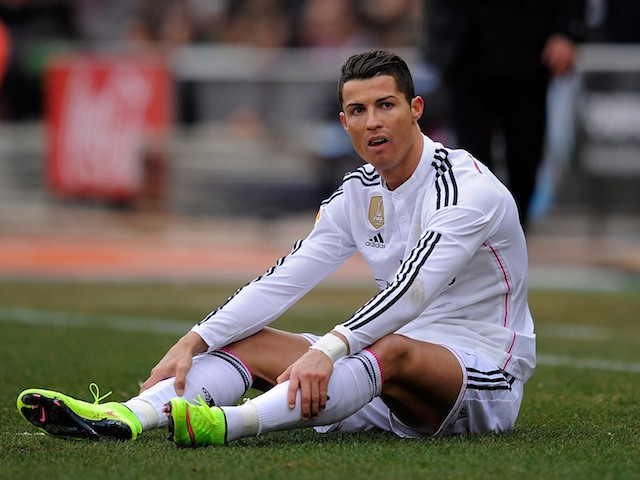 Cristiano Ronaldo of Real Madrid looks on after taking a fall during the La Liga match between Club Atletico de Madrid and Real Madrid on February 7, 2015