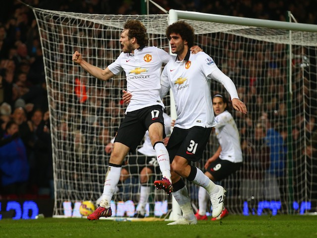 Daley Blind of Manchester United celebrates scoring their first goal with Marouane Fellaini during the Barclays Premier League match against West Ham on February 8, 2015