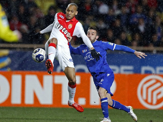 Monaco's Brazilian defender Fabinho vies for the ball with Bastia's French defender Julian Palmieri the French League Cup quarter-final football match between Monaco (ASM) and Bastia (SCB) on February 4, 2015