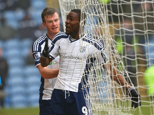 Brown Ideye of West Brom celebrates scoring their second goal with Chris Brunt of West Brom during the Barclays Premier League match between Burnley and West Bromwich Albion at Turf Moor on February 8, 2015