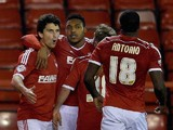 Britt Assombalonga of Nottingham Forest is congratulated after scoring the opening goal during the Sky Bet Championship match against Wigan on February 11, 2015