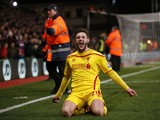 Liverpool's English midfielder Adam Lallana celebrates