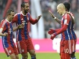 Bayern Munich's Rafinha, Mehdi Benatia, Arjen Robben and David Alaba celebrate a goal against Hamburg on February 14, 2015