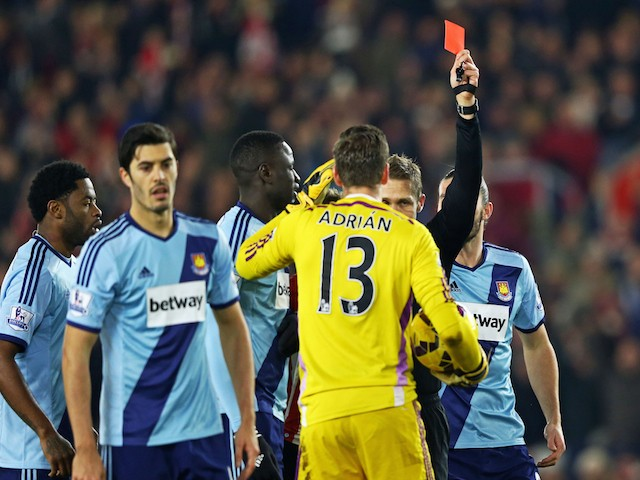 Adrian of West Ham receives a red card from referee Craig Pawson after diving on the ball outside of the area ahead of Sadio Mane of Southampton during the Premier League match on February 11, 2015