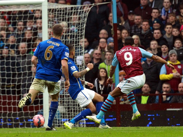 Aston Villa's English midfielder Scott Sinclair shoots to scores their second goal during the FA Cup fifth round football match between Aston Villa and Leicester City at Villa Park in Birmingham, central England on February 15, 2015