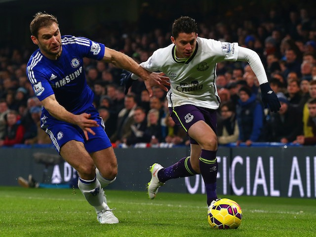 Branislav Ivanovic of Chelsea and Bryan Oviedo of Everton battle for the ball during the Barclays Premier League match on February 11, 2015