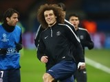 Paris Saint-Germain's David Luiz warms up ahead of the Champions League encounter with his former side Chelsea on February 17, 2015