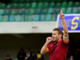 Roma's forward Francesco Totti celebrates after scoring a goal during their Serie A football match Verona vs AS Roma at Bentegodi Stadium in Verona, on February 22, 2015