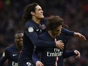 Paris Saint-Germain's French midfielder Adrien Rabiot (R) is congratuled by Paris Saint-Germain's Uruguayan forward Edinson Cavani after scoring a goal during the French L1 football match between Paris Saint-Germain (PSG) and Toulouse (TFC) on February 21