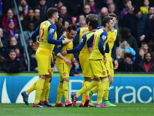 Santi Cazorla of Arsenal celebrates with team mates as he scores their first goal from a penalty during the Barclays Premier League match between Crystal Palace and Arsenal at Selhurst Park on February 21, 2015