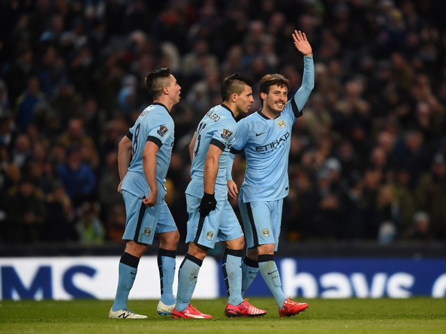 David Silva of Manchester City celebrates scoring their fourth goal during the Barclays Premier League match between Manchester City and Newcastle United at Etihad Stadium on February 21, 2015