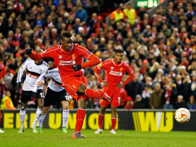 Mario Balotelli of Liverpool scores the opening goal from the penalty spot during the UEFA Europa League Round of 32 match against Besiktas on February 19, 2015