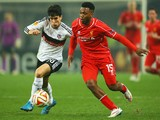 Daniel Sturridge of Liverpool takes on Necip Uysal of Besiktas during the UEFA Europa League Round of 32 second leg match on February 26, 2015