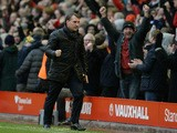 Liverpool's Northern Irish manager Brendan Rodgers celebrates at the final whistle in the English Premier League football match between Liverpool an